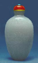 An Archaic carved Jade Chinese Snuff Bottle, John Neville Cohen